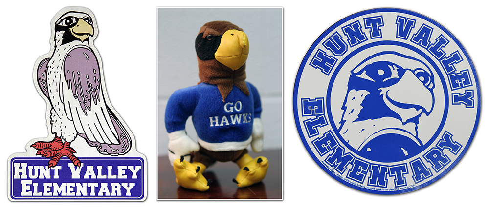 Photograph showing three versions of the hawk mascot as it appeared in different time periods.