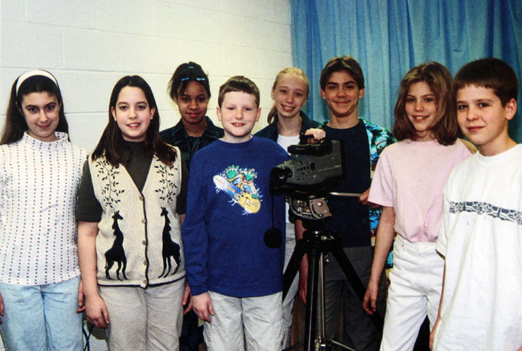 Photograph of students with a video camera.